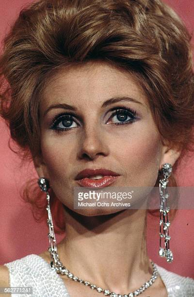 "Actress Jill Ireland poses backstage after presenting "" Best Supporting Actress"" award during the 46th Academy Awards at Dorothy Chandler Pavilion in..."