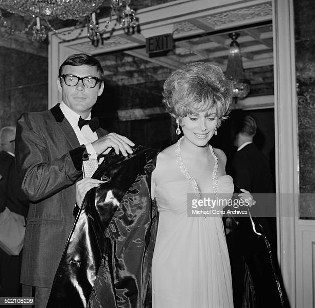 Actress Jill St John and actor Adam West attend the premiere of The Bible in Los AngelesCA