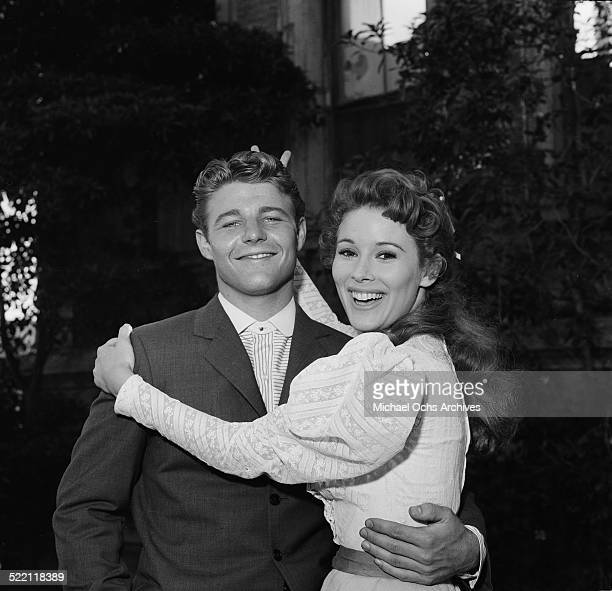Actress Jill St John poses with actor David Nelson on set in Los AngelesCA