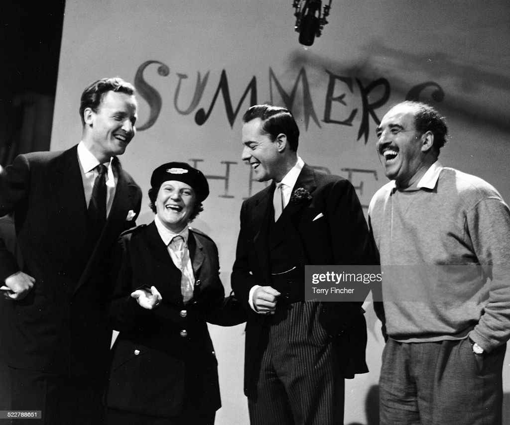 Actress Jill Summer sharing a joke on stage with members of her show (L-R) Nicholas Parsons, Terrence Alexander and Harry Lane, at ITV Studios, Wood Green, London, August 1957.