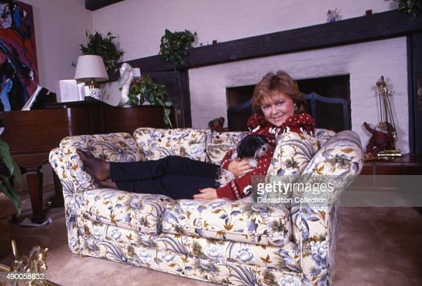 Actress Jill Whelan poses for a portrait session at home wearing a Christmas sweater in 1985 in Los Angeles California