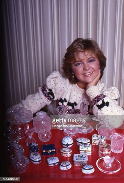 Actress Jill Whelan poses for a portrait session at home with a collection of glass boxes in 1985 in Los Angeles California