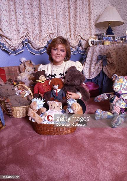 Actress Jill Whelan poses for a portrait session at homewith her stuffed animals in 1985 in Los Angeles California