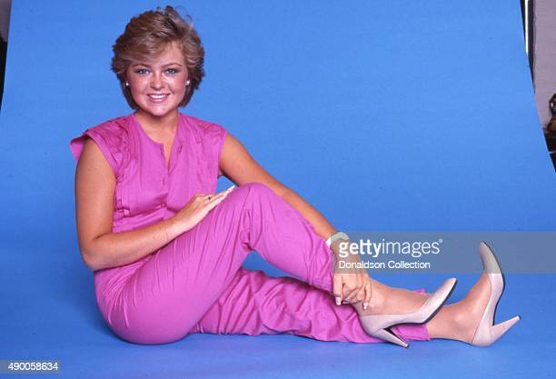 Actress Jill Whelan poses for a portrait session wearing a pink one piece suit in 1984 in Los Angeles California