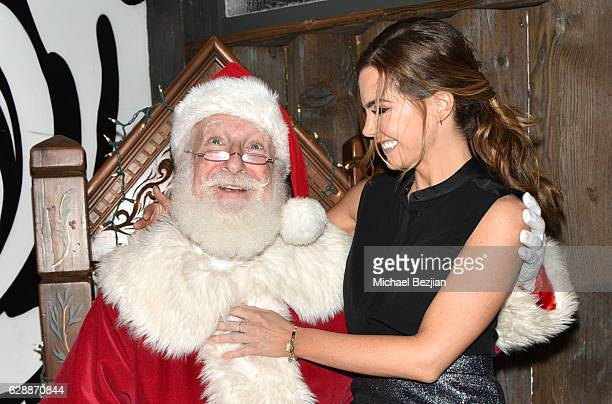 Actress Jillian Murray and Santa at Not For Sale x Z Shoes Benefit at Estrella Sunset on December 9, 2016 in West Hollywood, California.