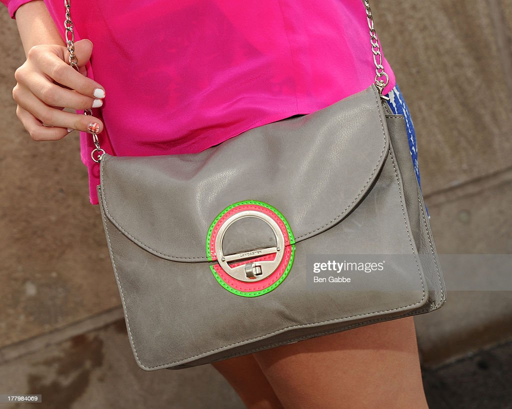Actress Jillian Rose Reed (bag detail) at The Empire State Building on August 26, 2013 in New York City.