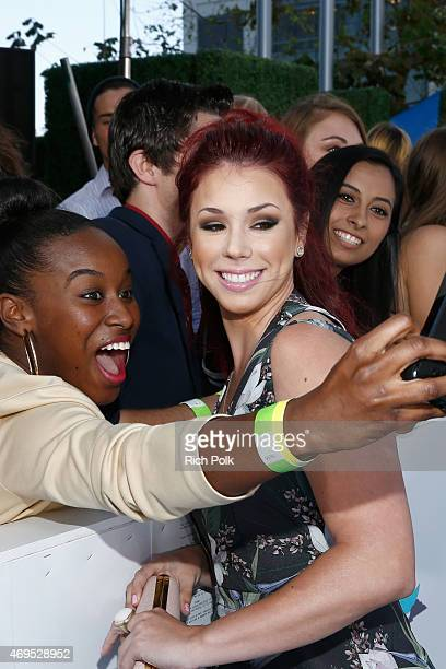 Actress Jillian Rose Reed poses for a selfie photo with a fan at The 2015 MTV Movie Awards at Nokia Theatre LA Live on April 12 2015 in Los Angeles...