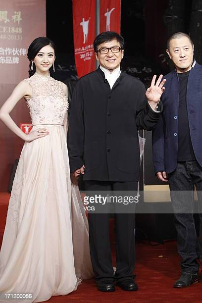 Actress Jing Tian and actor Jackie Chan arrive at the closing ceremony of 16th Shanghai International Film Festival at Shanghai Culture Square on...