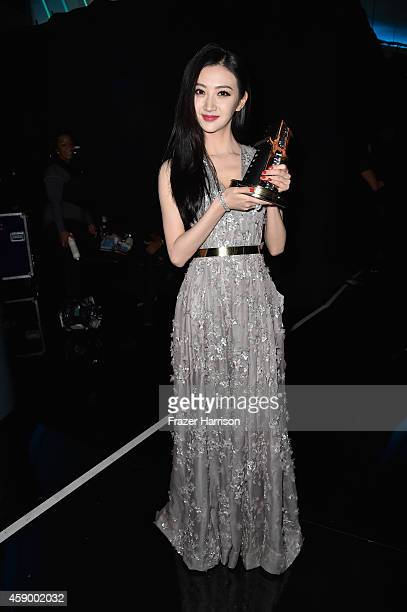 Actress Jing Tian poses backstage during the 18th Annual Hollywood Film Awards at The Palladium on November 14 2014 in Hollywood California
