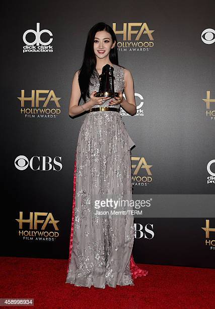 Actress Jing Tian winner of the Hollywood International Award poses in the press room during the 18th Annual Hollywood Film Awards at The Palladium...