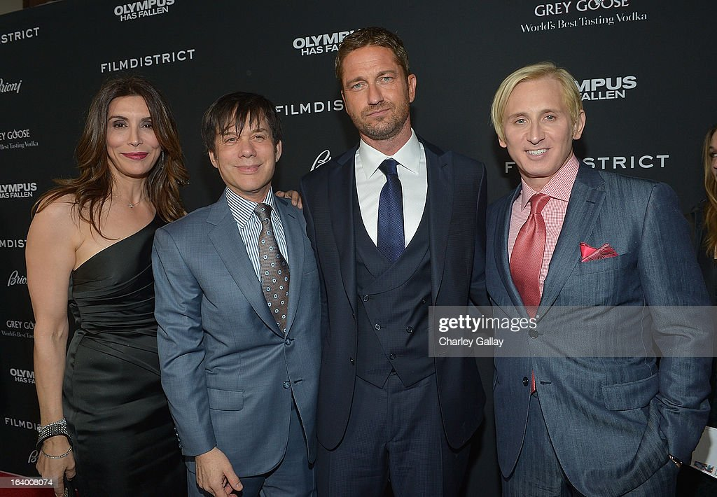 Actress Jo Champa, producer Alan Siegel, actor Gerard Butler and designer David Meister attend Brioni Sponsors Film District's World Premiere Of 'Olympus Has Fallen' ArcLight Cinemas on March 18, 2013 in Hollywood, California.