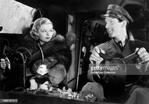 Actress Joan Bennett and Fred MacMurray in a scene from the movie 13 Hours by Air