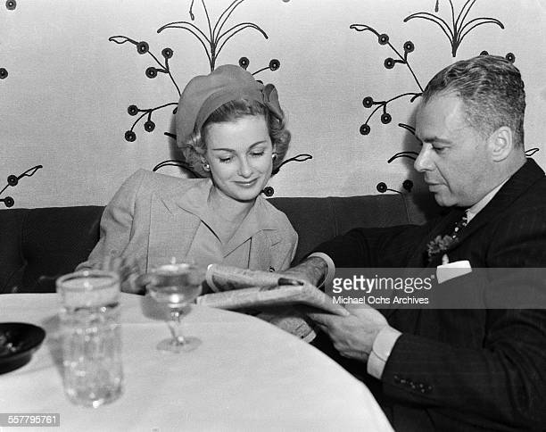 Actress Joan Bennett has a meal with husband Walter Wanger in Los Angeles California