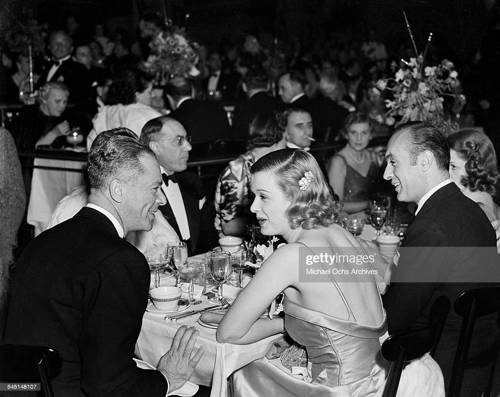 Actress Joan Bennett, husband producer Walter Wanger (L) and actor Charles Boyer (R) attend an event in Los Angeles, California.