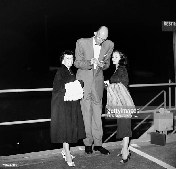 Actress Joan Bradshaw poses with a tall man in Los AngelesCalifornia