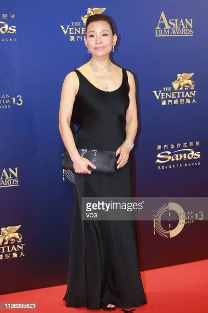 Actress Joan Chen poses on the red carpet of the 13th Asian Film Awards on March 17 2019 in Hong Kong China
