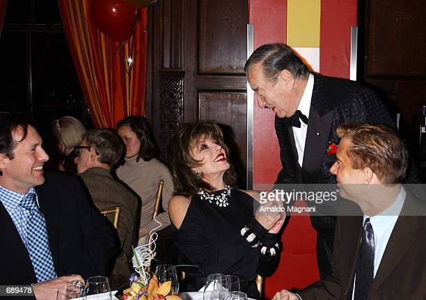 Actress Joan Collins and her boyfriend Percy Gibson chat with LeCirque Restaurant owner Sirio Maccioni December 31 2001 at a New Years Eve dinner...