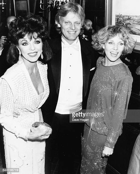 Actress Joan Collins and her husband Peter Holm with their hostess actress Madeleine Curtis at Stocks nightclub in Chelsea London November 24th 1985