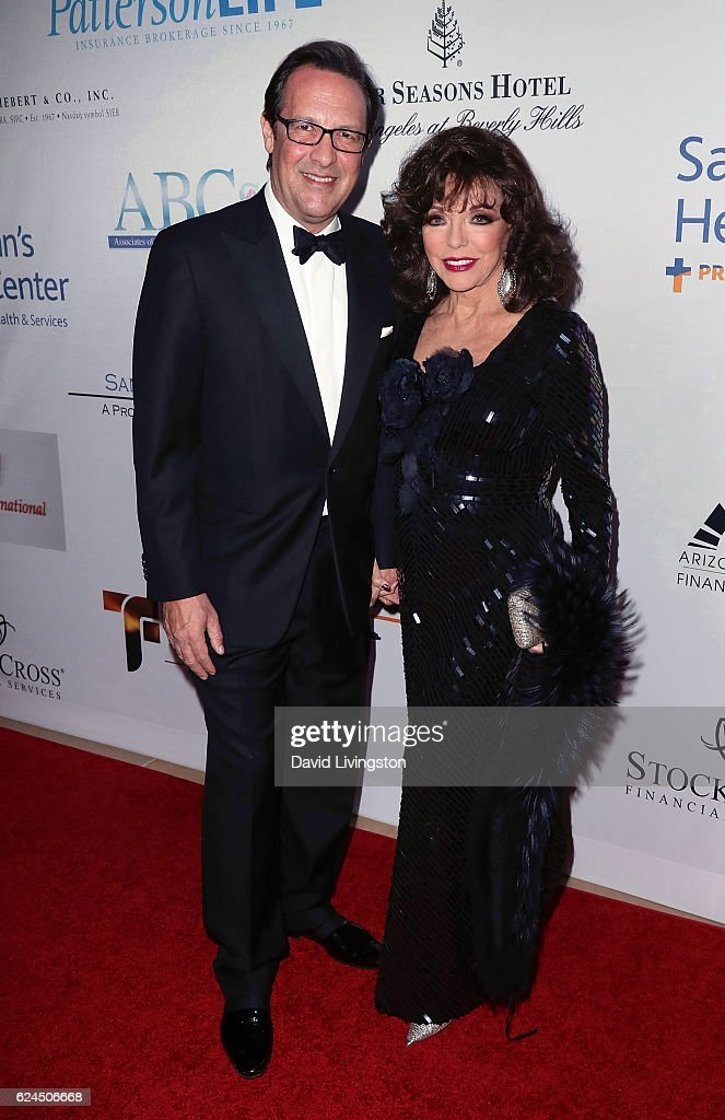 Actress Joan Collins (R) and husband Percy Gibson attend the Talk of the Town Gala 2016 at The Beverly Hilton Hotel on November 19, 2016 in Beverly Hills, California.