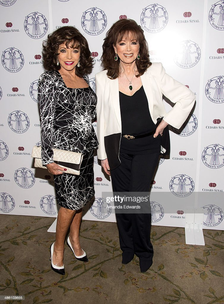 Actress Joan Collins (L) and writer Jackie Collins arrive at the Women's Guild Cedars-Sinai Luncheon at Beverly Hills Hotel on April 22, 2014 in Beverly Hills, California.