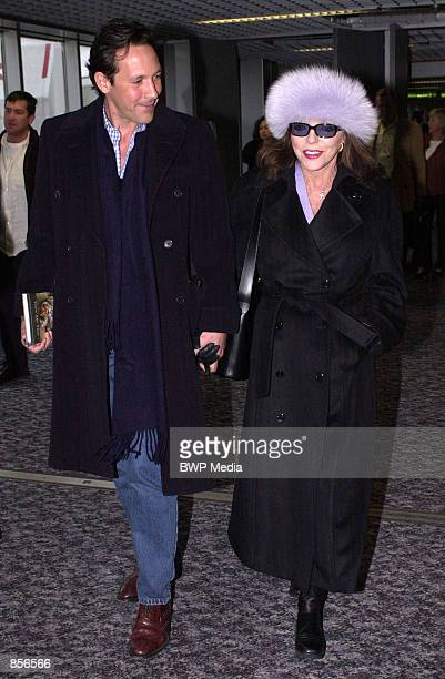 Actress Joan Collins arrives with fiance Percy Gibson February 4 2002 at Heathrow airport outside London England The 68yearold star has said she will...