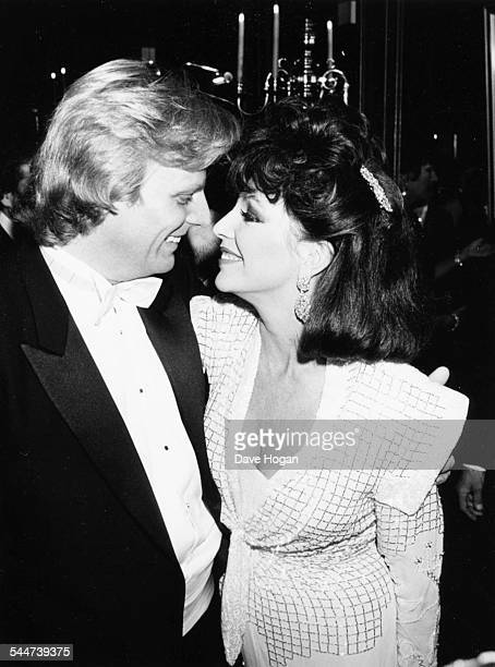 Actress Joan Collins looking into the eyes of her husband Peter Holm at Stocks nightclub in Chelsea London November 24th 1985