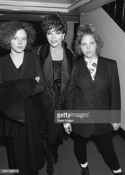 Actress Joan Collins with her daughter Katie and Tara attending a performance of her exhusband Tony Newley's musical 'Stop the World I Want to Get...