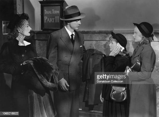 Actress Joan Crawford and Dana Andrews Connie Marshall Peggy Ann Garner in a scene from the movie Daisy Kenyon