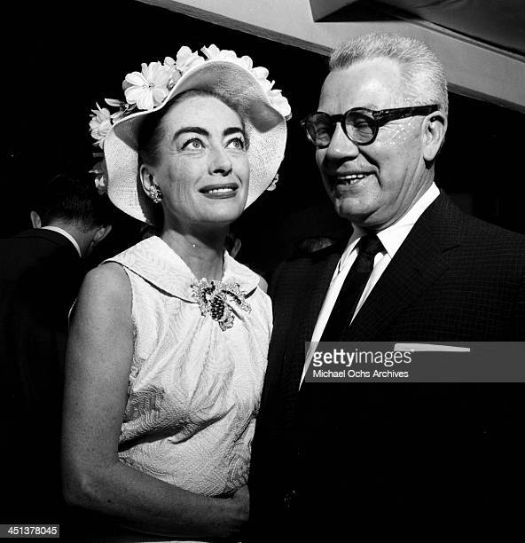 Actress Joan Crawford and her husband Al Steele attend a premiere in Los Angeles California