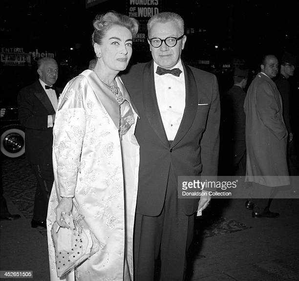 Actress Joan Crawford and her husband PepsiCola Company CEO Alfred Steele attend a Jerry Lewis show at the RKO Palace Theater on Broadway on February...