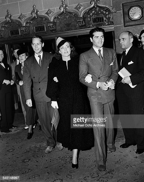 Actress Joan Crawford and husband Franchot Tone and Francis Lederer arrive at an event in Los Angeles California