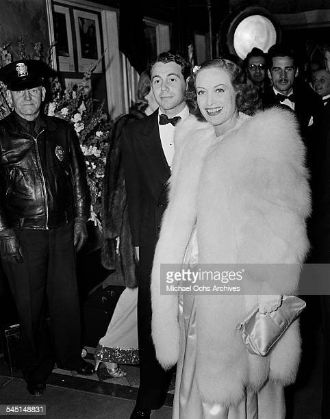 Actress Joan Crawford and husband Phillip Terry arrive at a Ball event in Los Angeles California