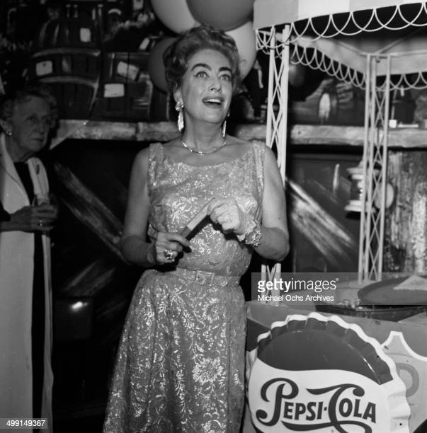 Actress Joan Crawford attend a party in Los Angeles California