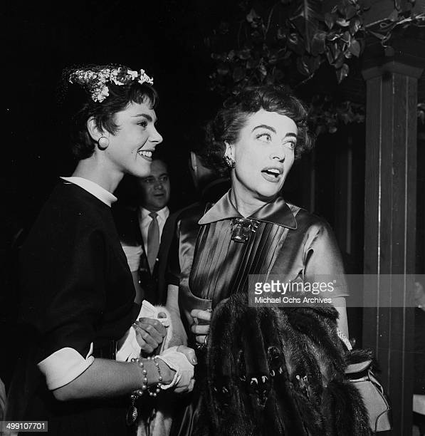 Actress Joan Crawford with guest attends Don O'Conner party in Los Angeles California