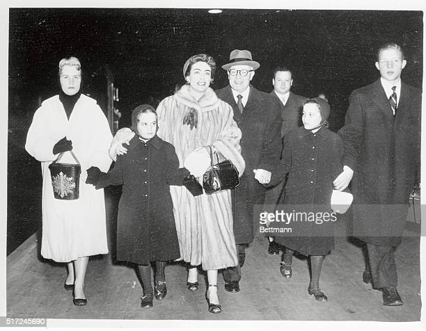 Actress Joan Crawford with her adopted children Christina Cathy Cynthia and Christopher Others are unidentified