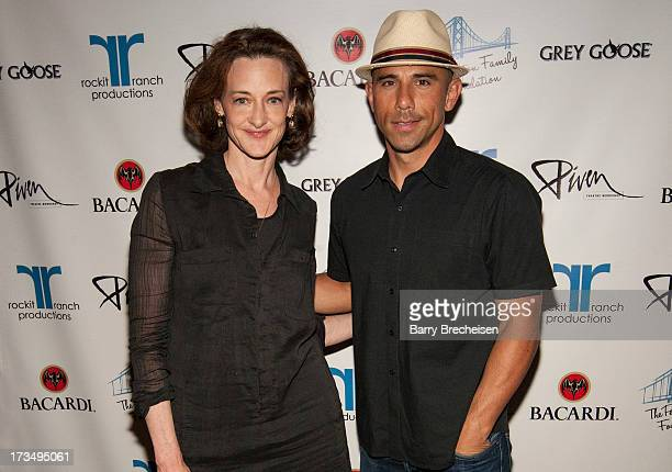 Actress Joan Cusack and Rockit Ranch CEO Billy Dec attend the Piven Theatre Workshop Gala at the Rockbit Bar Grill on July 13 2013 in Chicago Illinois