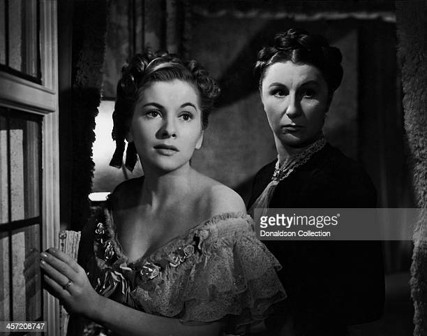 Actress Joan Fontaine and Judith Anderson pose for a portrait for the movie 'Rebecca' released in 1940