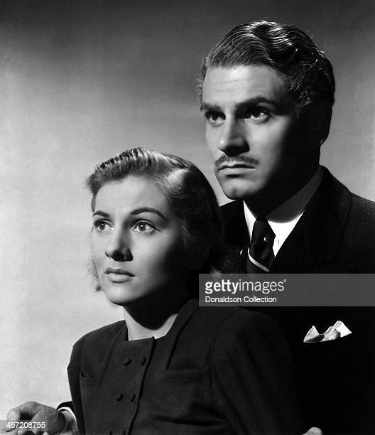 Actress Joan Fontaine and Laurence Olivier pose for a portrait for the movie 'Rebecca' released in 1940
