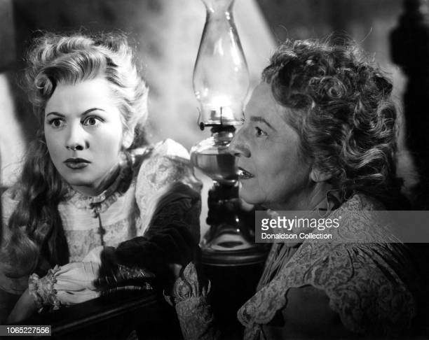 Actress Joan Fontaine and Lucille Watson in a scene from the movie Ivy
