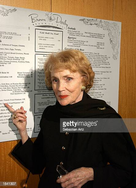 Actress Joan Leslie points at the menu of the legendary Brown Derby Restaurant May 10 2002 in Los Angeles CA
