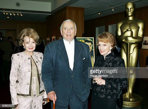 Actress Joan Leslie poses with Gore Vidal author and Cora Sue Collins actress at the Academy of Motion Picture Arts and Sciences Centennial tribute...