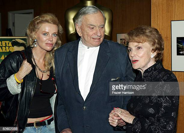 Actress Joan Leslie poses with Gore Vidal author and Kristina Wayborn actress at the Academy of Motion Picture Arts and Sciences Centennial tribute...