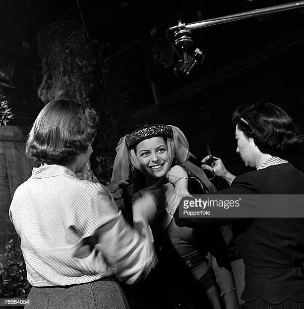 "Actress Joan Rice being made up, on the set of the film ""Robin Hood"""