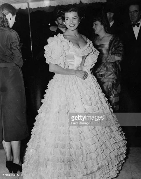 Actress Joan Rice wearing a ruffled gown as she attends the premiere of the film 'The Magic Box' at the Odeon, Leicester Square, September 18th 1951.