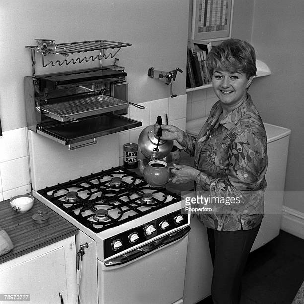 Actress Joan Sims star of the Carry On films pictured pouring a cup of tea in her kitchen at home 1967
