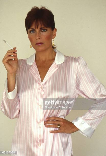 Actress Joanna Cassidy poses for a portrait session holding a cigarette in circa 1987 in Los Angeles California
