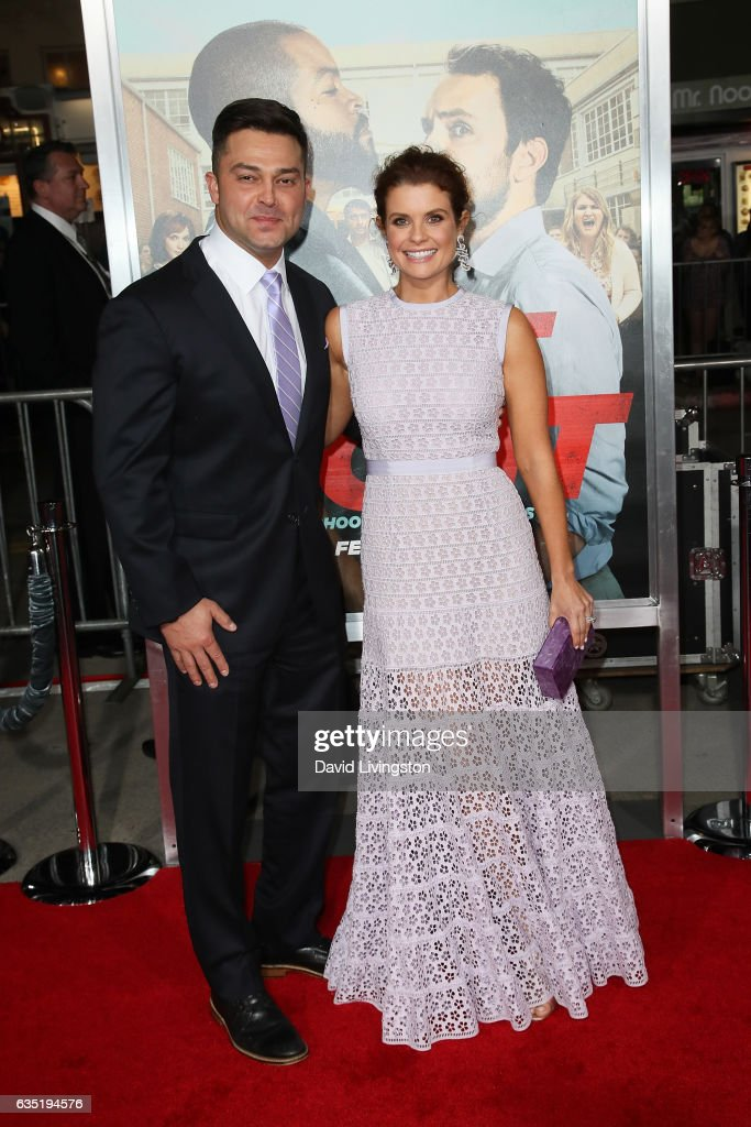 Actress JoAnna Garcia (R) and Nick Swisher attend the premiere of Warner Bros. Pictures' 'Fist Fight' at Regency Village Theatre on February 13, 2017 in Westwood, California.