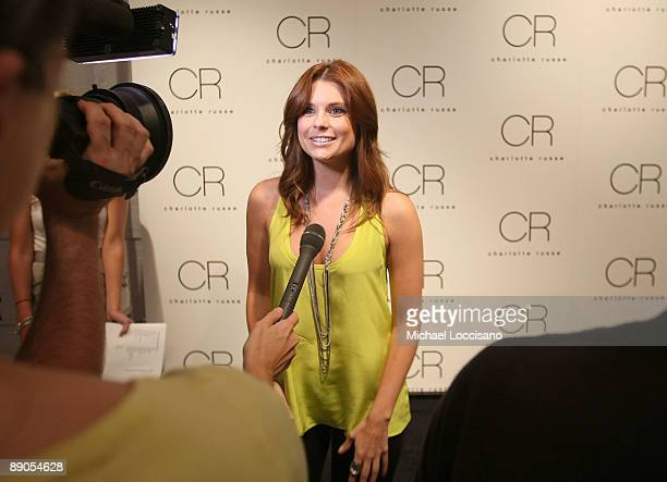Actress Joanna Garcia is interviewed during the Charlotte Russe Fall 2009 launch event at Openhouse Gallery on July 15 2009 in New York City
