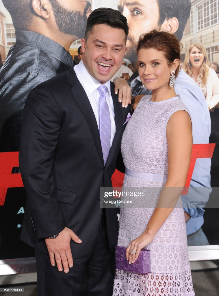 Actress JoAnna Garcia Swisher and husband Nick Swisher arrive at the premiere of Warner Bros. Pictures' 'Fist Fight' at Regency Village Theatre on February 13, 2017 in Westwood, California.