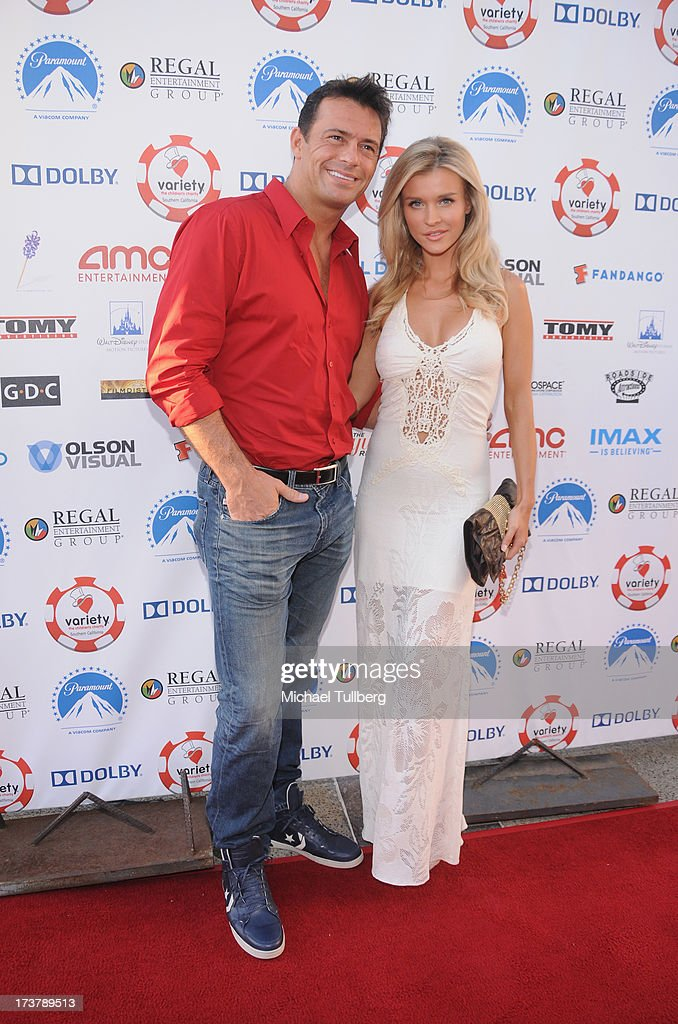 Actress Joanna Krupa (R) and husband Romain Zago attends the 3rd Annual Variety Charity Texas Hold 'Em Tournament & Casino Game at Paramount Studios on July 17, 2013 in Hollywood, California.